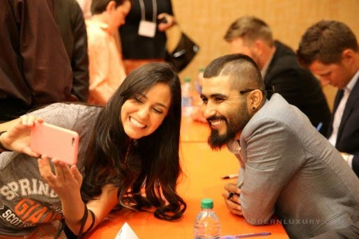 A fan takes a selfie with San Francisco Giants pitcher Sergio Romo