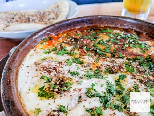 Shakshuka: chickpea, peppers & tomato stew, griddled halloumi, baked eggs with pita